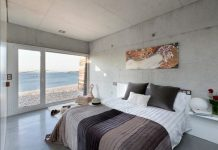 trang trí phòng ngủ với tường bê tông